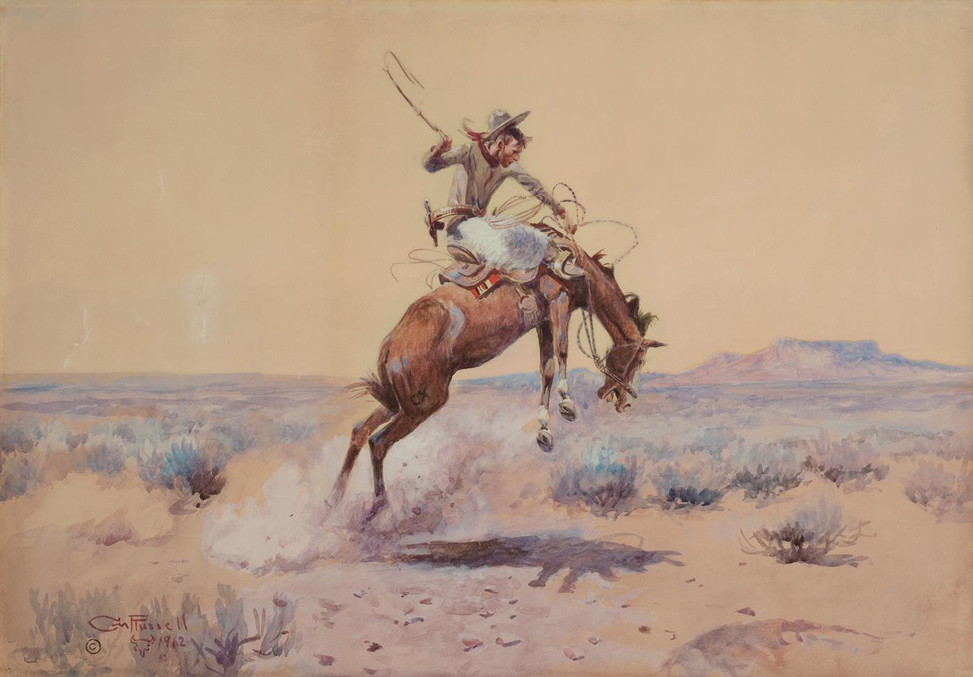 A cowboy rides a bucking horse in an open landscape.