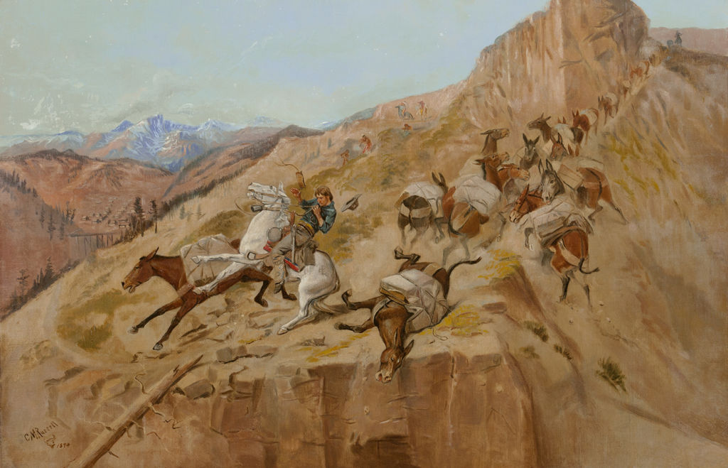 An Anglo horse rider and train of pack mules struggle and slide off a narrow mountain path as shots are fired at them.