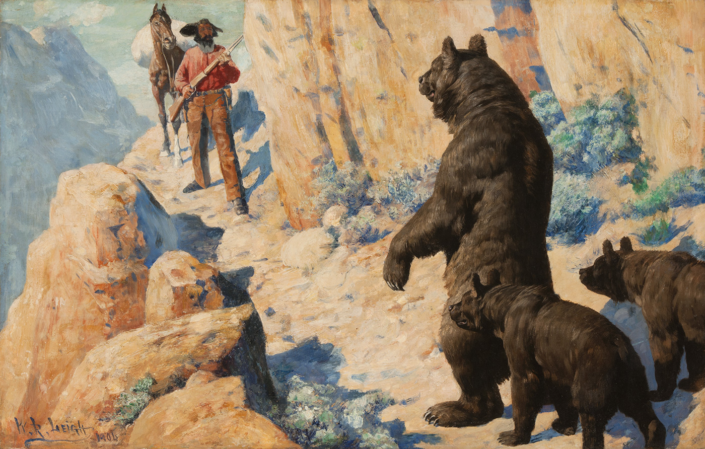A man on a mountain path faces a standing bear with two cubs.