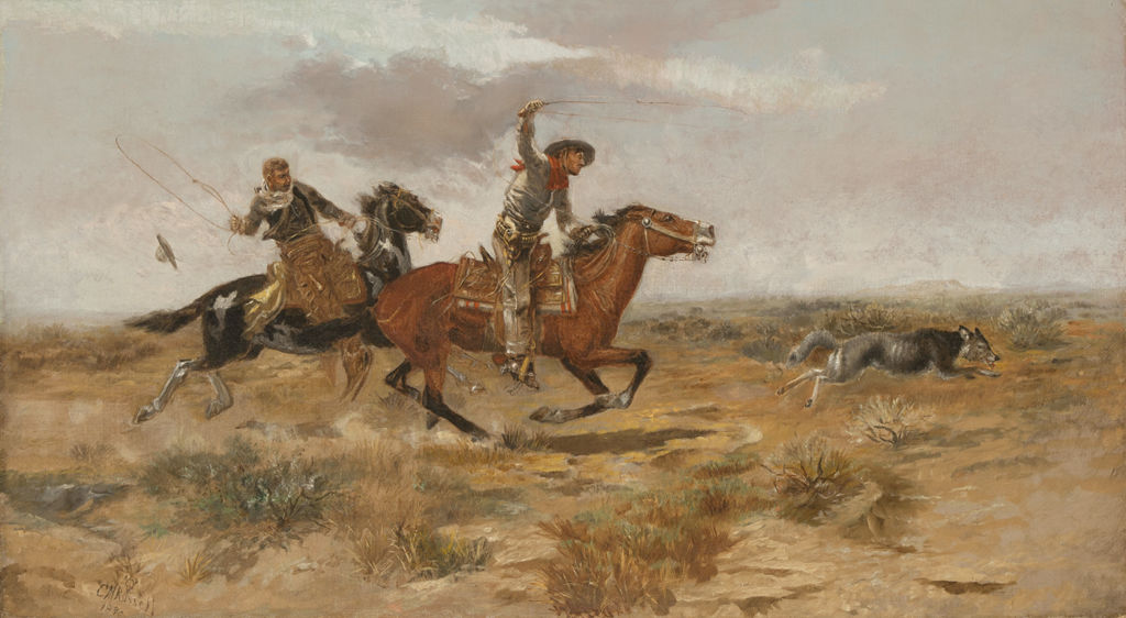 Two men on horses are attempting to rope a wolf.