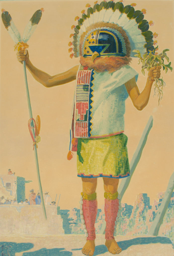 A full length portrait of a Hopi man in tribal clothing.