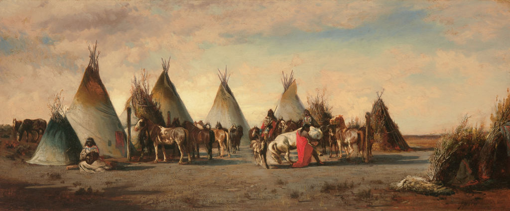 A group of indigenous Americans gather with many horses inside a perimeter of tipis.