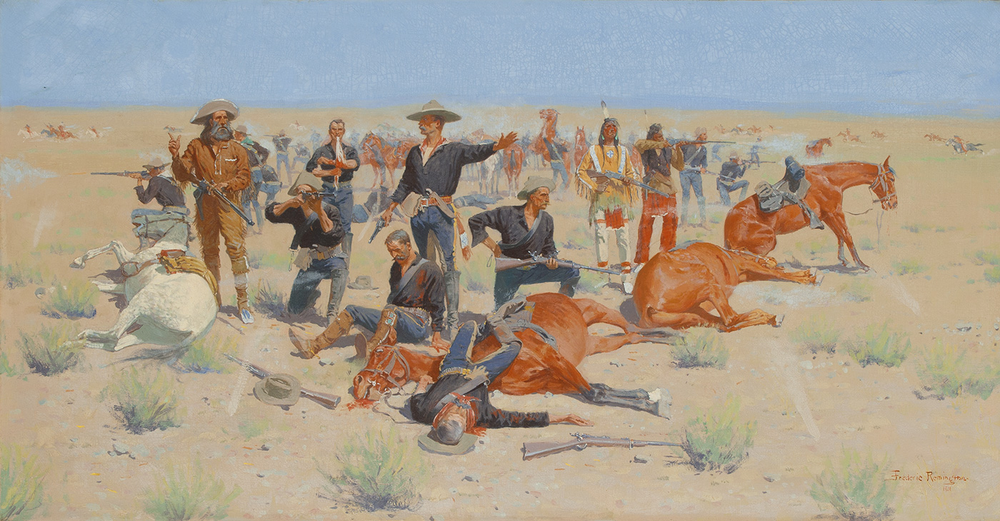 A diverse group of men including soldiers and indigenous Americans aim and shoot their rifles from behind fallen horses.