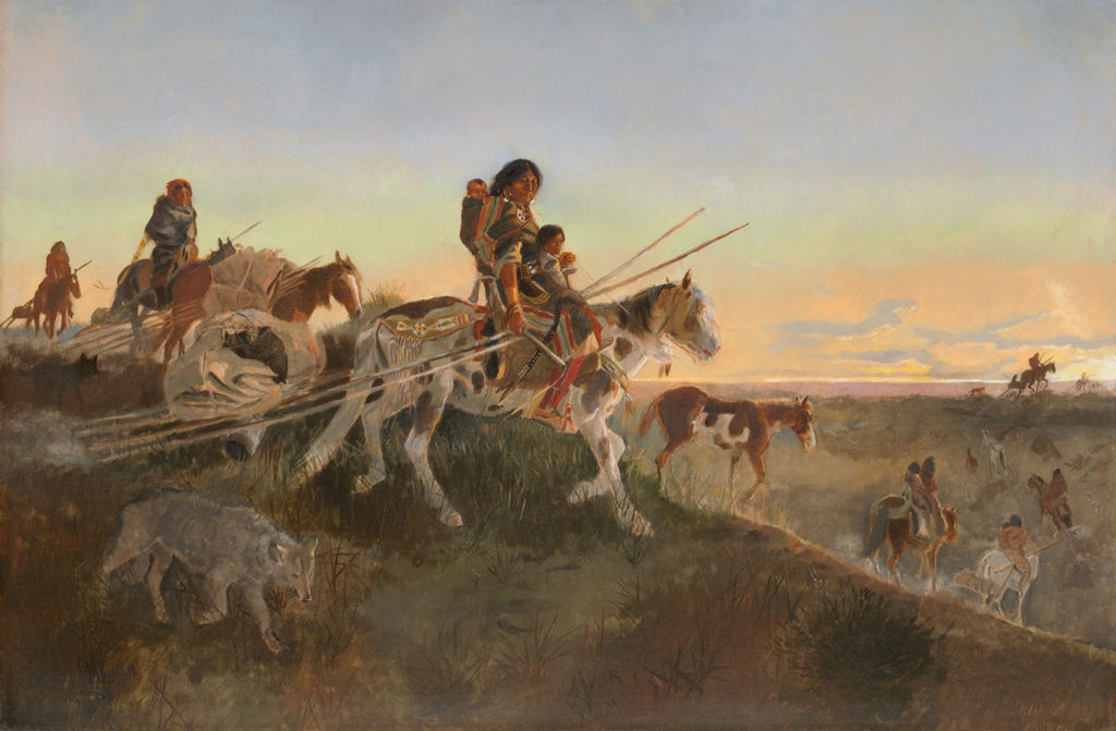 A group of indigenous American women and children ride horses through a hilly landscape.