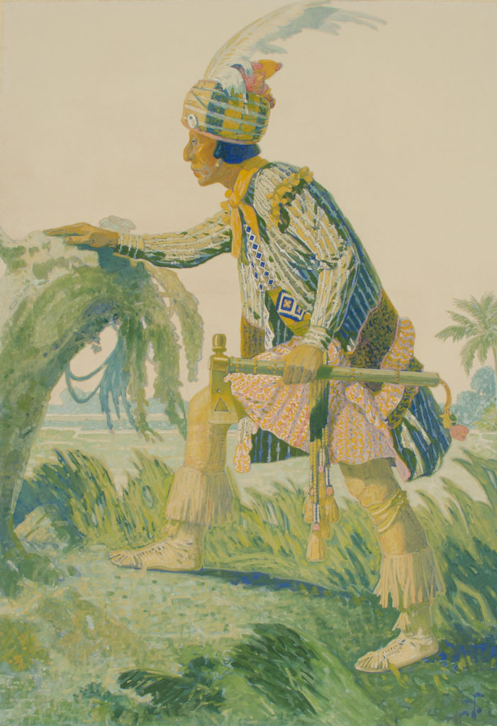 A full length portrait of a Seminole man in tribal clothing.