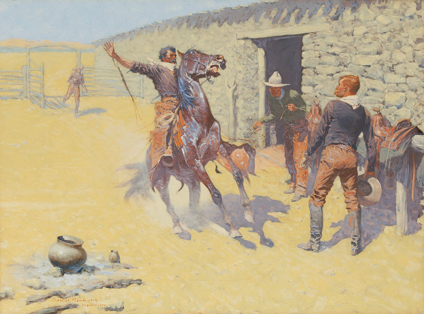 A cowboy on horseback comes to a halt with his hand in the air in front of two standing cowboys.