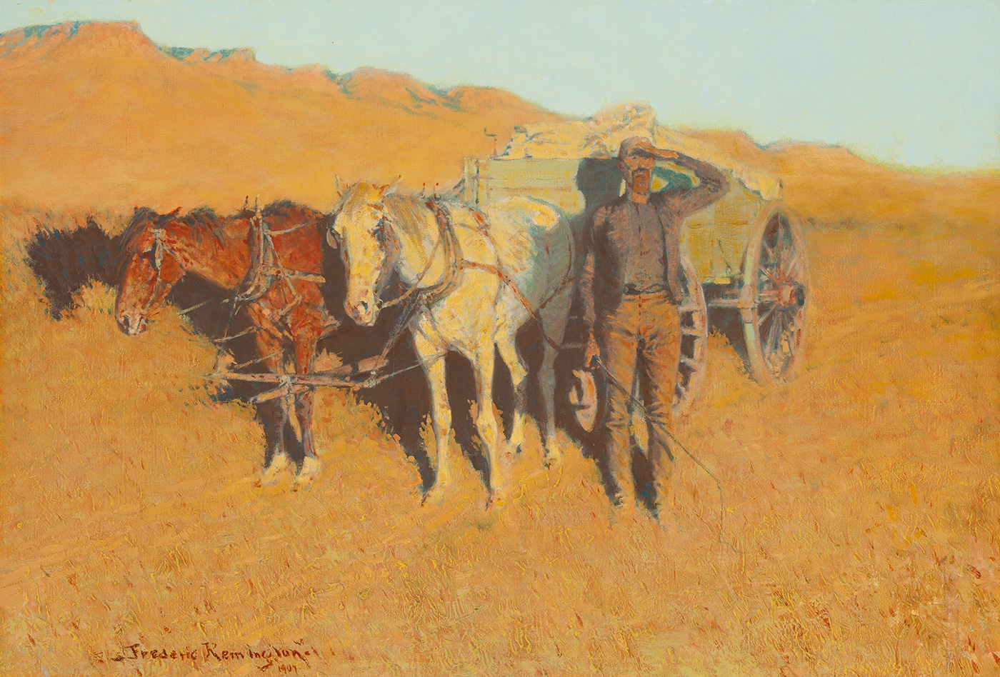 An Anglo man stands next to a cart and two horses shielding his eyes from the sun.