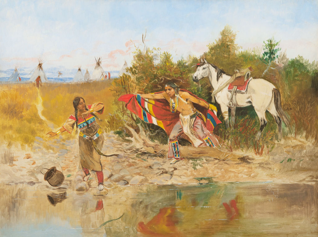 A young indigenous American man approaches an indigenous woman by a stream.