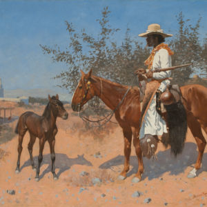 A man rides a brown horse with a city in the background.