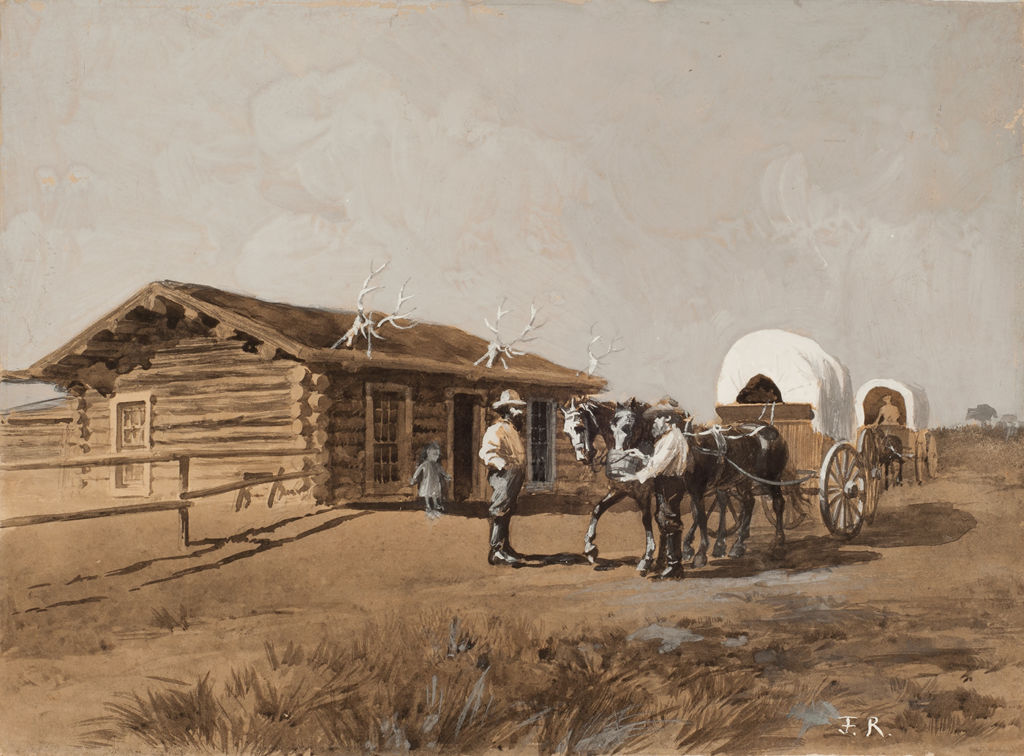 Two Anglo men meet next to a small train of covered wagons outside a log cabin.